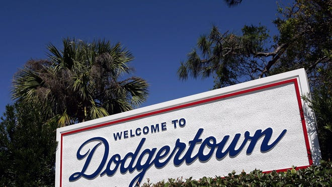 """VERO BEACH, FL - MARCH 2: A """"Welcome to Dodgertown"""" sign is seen during the Los Angeles Dodgers spring training game against the Florida Marlins on March 2, 2005 at Holman Stadium in Vero Beach, Florida. The Dodgers defeated the Marlins 4-2. (Photo by Ronald Martinez/Getty Images)"""