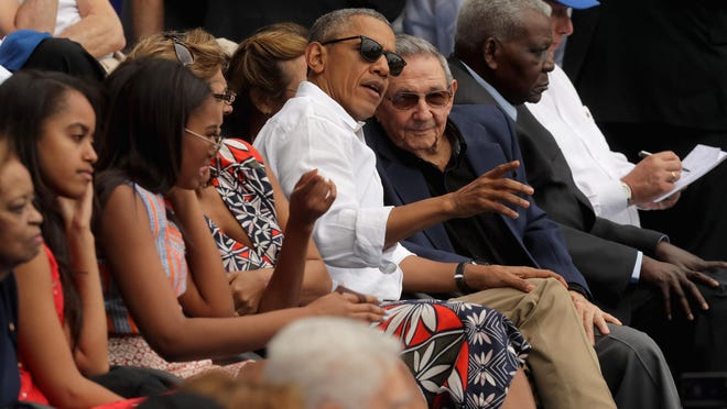 President Barack Obama and Cuban President Raul Castro visit during an exhibition game between the Cuban national team and the Tampa Bay Rays at the Estado Latinoamericano in Havana, Cuba. This is the first time a sitting president has visited Cuba in 88 years.