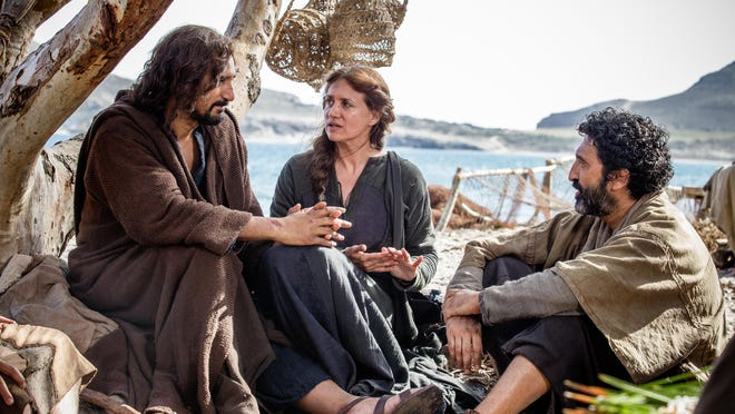 """Jesus (Cliff Curtis) with Mary (Maria Botto) and James (Selva Rasalingam) and his other apostles on the shores of the Sea of Galilee in the film """"Risen."""""""