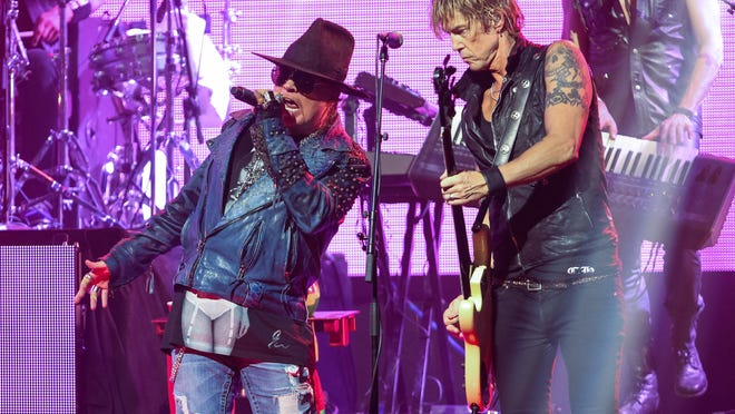 Guns N' Roses, including Axl Rose, left, and Duff McKagan will headline Coachella April 15-17 and April 22-24. Locals passes go on sale on Wednesday, April 13.