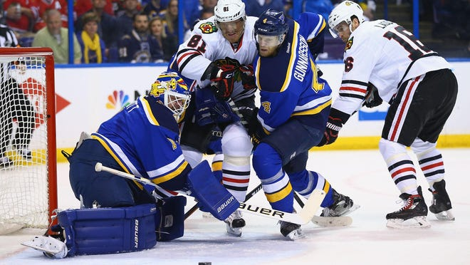 Brian Elliott (1) and Carl Gunnarsson (44) of the Blues defend their goal against Marian Hossa (81) and Andrew Ladd (16) of the Blackhawks in Game 2 of the Western Conference quarterfinals on Friday at the Scottrade Center in St. Louis.