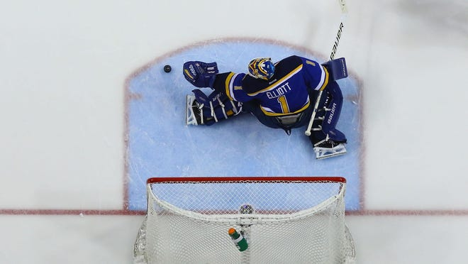 In this file photo, Brian Elliott of the St. Louis Blues makes a save against the Chicago Blackhawks in Game 1 of their quarterfinal series on April  27, 2016.