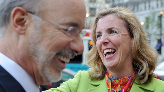 Democratic challenger Katie McGinty, seen here with Gov. Tom Wolf, left, is battling for a U.S. Senate seat in Pennsylvania against Republican incumbent Pat Toomey.