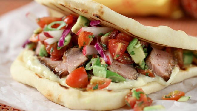 Tuna tacos with sesame wasabi cream and a tomato-avocado salsa taste great on tortillas or on naan.