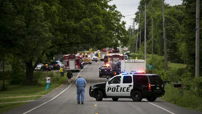 CORRECTS FROM COPPER TO COOPER- Police and rescue workers attend to the scene after multiple bicyclists were struck by a vehicle in a deadly crash Tuesday, June 7, 2016, in Cooper Township, Mich. (Chelsea Purgahn/Kalamazoo Gazette-MLive Media Group via AP) LOCAL TELEVISION OUT; LOCAL RADIO OUT; MANDATORY CREDIT