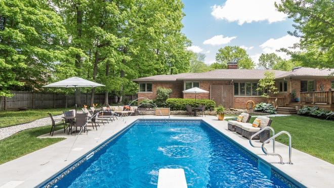 A sunny day invites a dip in the backyard pool.