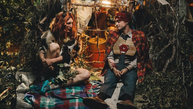 "Paul Dano, left, and Daniel Radcliffe appear in a scene from ""Swiss Army Man."""