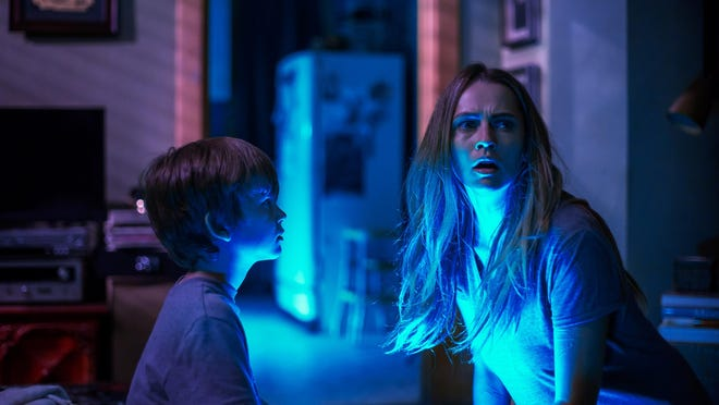 "Gabriel Bateman and Teresa Palmer in ""Lights Out."""