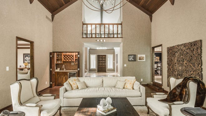 Architectural features on the ceiling and the walls make the 5,400-square-foot home distinctive.