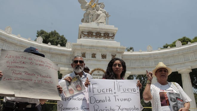 People protest at Hemiciclo a Juarez monument against the visit of U.S. Republican presidential candidate Donald Trump, in Mexico City, Mexico.