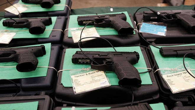 File photo: Guns sit for sale at a gun show in 2016 in Fort Worth, Texas.
