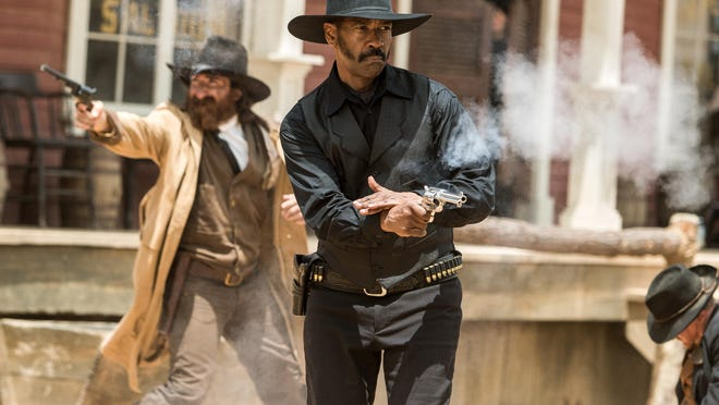 """In this image released by Sony Pictures, Denzel Washington appears in a scene from """"The Magnificent Seven."""" (Sam Emerson/Sony Pictures via AP)"""