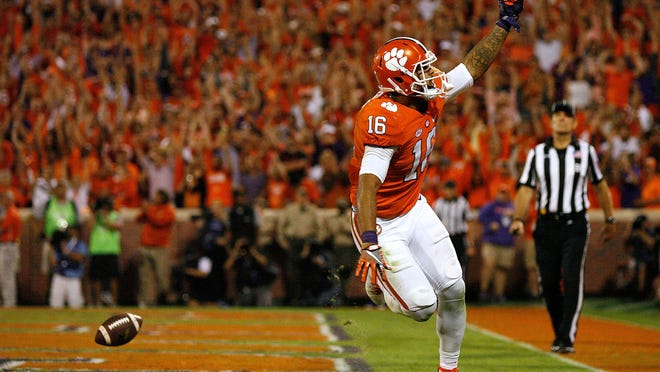 Clemson's Jordan Leggett celebrates after his fourth quarter go-ahead touchdown against the Louisville Cardinals at Memorial Stadium on Saturday in Clemson, South Carolina. The Tigers won, 42-36.
