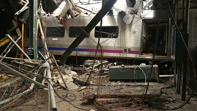 This Oct. 1, 2016, photo, provided by the National Transportation Safety Board, shows damage done to Hoboken Terminal after a commuter train crash.