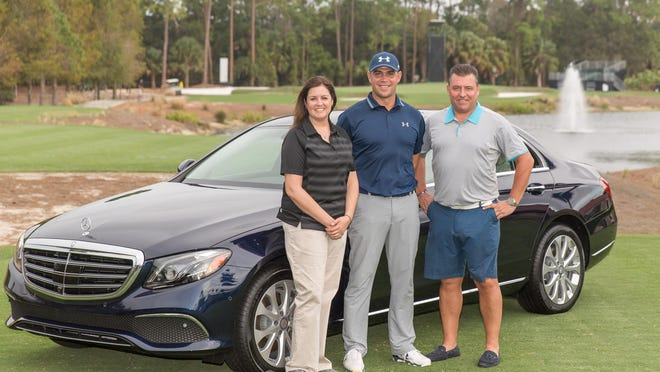 PGA Tour golfer Gary Woodland, center, stands with Mercedes Benz representatives on Tuesday after Woodland earlier in the day made a hole-in-one on No. 16 to win a Mercedes Benz during the Franklin Templeton Shootout Pro-Am.