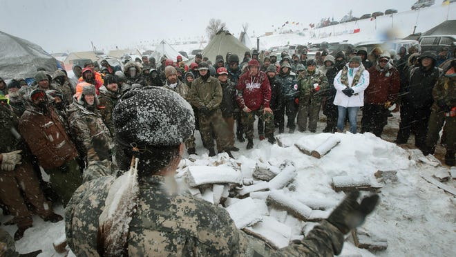 Military veterans are briefed Monday on cold-weather safety issues and their overall role at the sprawling Oceti Sakowin protest encampment on the edge of the Standing Rock Sioux Reservation outside Cannon Ball, North Dakota.