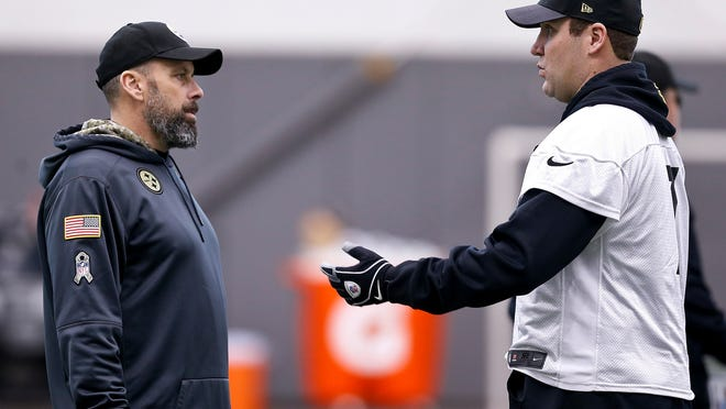 In this photo from Wednesday, Jan. 11, 2017, Pittsburgh Steelers offensive coordinator Todd Haley, left, talks with quarterback Ben Roethlisberger during NFL football practice in Pittsburgh. Haley insists there is no lingering resentment over his firing by the Kansas City Chiefs five years ago. But the fiery Pittsburgh offensive coordinator wouldn't mind showing the Chiefs what they missed out on when the Steelers visit Kansas City in an NFL AFC Divisional Playoff game on Sunday. (AP Photo/Keith Srakocic)