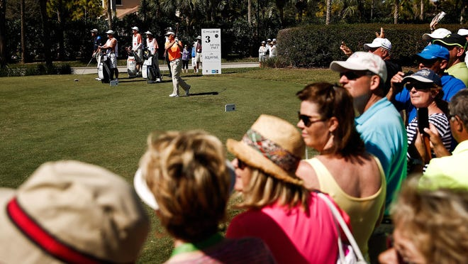 Spectators watch Bernhard Langer's shot during the final round of the Chubb Classic at TwinEagles Golf Club last year.