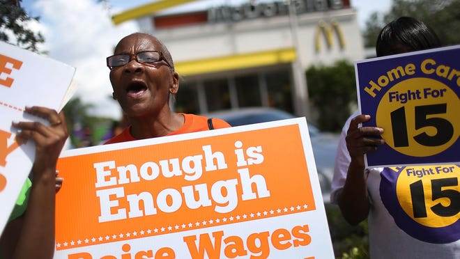 People demonstrate at a McDonald's in Fort Lauderdale during a rally for $15 minimum wage.