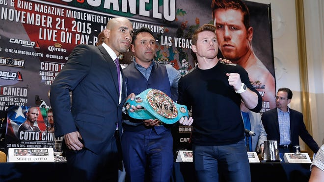 Miguel Cotto and Canelo Alvarez meet the press at the New Yorker ahead of their Nov. 21 middleweight championship fight. (Photo by John Lamparski/Getty Images)