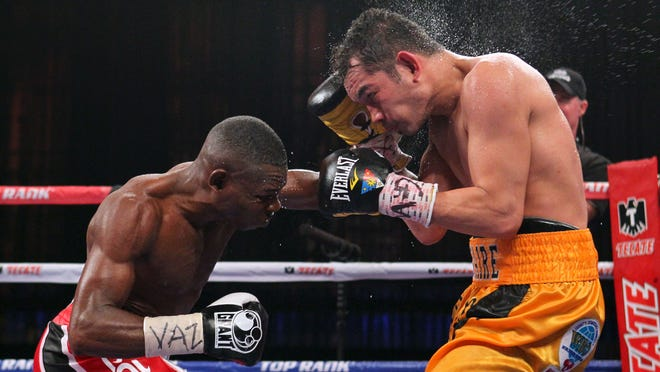 "Guillermo Rigondeaux, left, escaped from Cuba to pursue his dream of boxing professionally, a harrowing tale recounted in the new book ""The Domino Diaries."" (Ed Mulholland-USA TODAY Sports)"