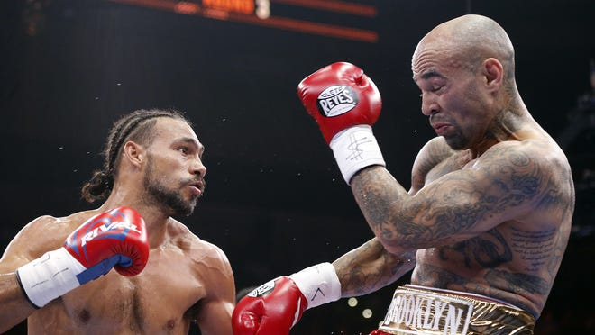 Keith Thurman, left, exchanged blows with Luis Collazo during their WBA Welterweight title fight on Saturday. (Photo: Brian Blanco, Getty Images)