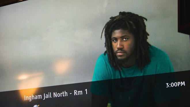 Via a live feed from the Ingham County jail, former MSU football player Auston Robertson, 19, is arraigned for 3rd degree criminal sexual conduct via video in Magistrate Mark Blumer's Ingham County 55th District court Tuesday, April 25, 2017, at the Ingham County Courthouse.