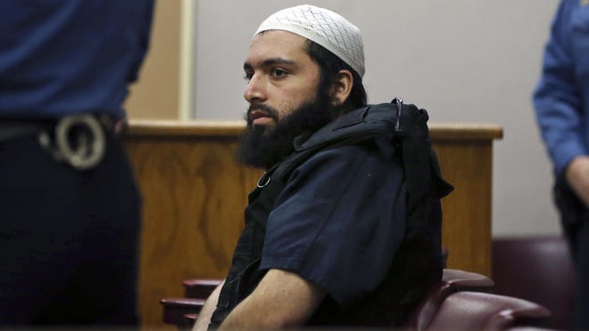 FILE - In this Dec. 20, 2016 file photo, Ahmad Khan Rahimi, the man accused of setting off bombs in New Jersey and New York's Chelsea neighborhood, sits in court in Elizabeth, N.J. The trial of Rahimi will occur in Manhattan after a judge on Monday, May 8, 2017, rejected a request by defense lawyers to move it to Vermont or Washington, D.C., on the grounds prejudicial publicity will have less effect on potential jurors there. (AP Photo/Mel Evans, File)