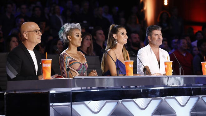 """In this Tuesday, Aug. 22, 2017 photo provided by NBC, judges Howie Mandel, Mel B, Heidi Klum and Simon Cowell participate in a live broadcast of """"America's Got Talent"""" in Los Angeles."""