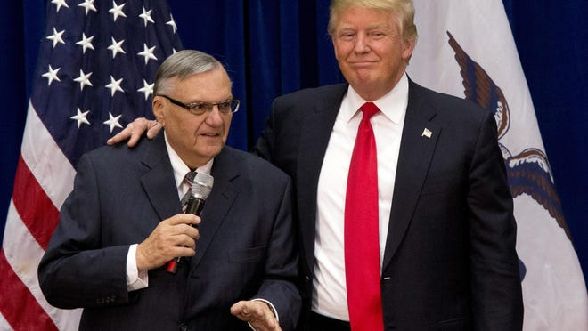 In this Jan. 26, 2016 photo, then-Republican presidential candidate Donald Trump is joined by Joe Arpaio, the sheriff of metro Phoenix, at a campaign event in Marshalltown, Iowa.