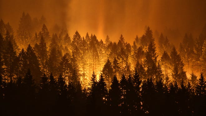 The Eagle Creek wildfire burns on the Oregon side of the Columbia River Gorge near Cascade Locks, Ore., in early September.