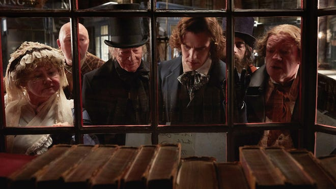 """Christopher Plummer, center left, is Ebenezer Scrooge and Dan Stevens, center right, is Charles Dickens in """"The Man Who Invented Christmas."""""""