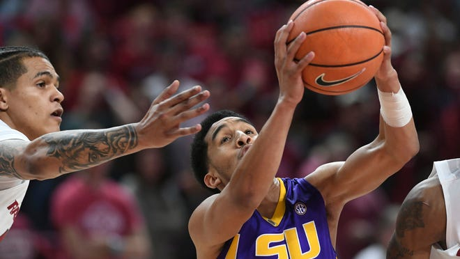 LSU's Tremont Waters gets a rebound in front of Arkansas' Dustin Thomas during an NCAA college basketball game Wednesday, Jan. 10, 2018, in Fayetteville, Ark. (T.J. Wampler/The Northwest Arkansas Democrat-Gazette via AP)