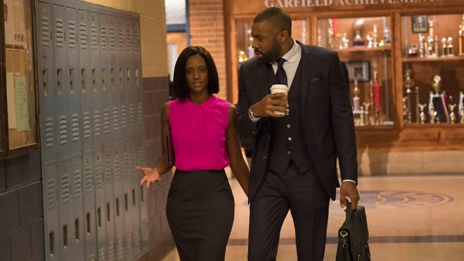 Skye P. Marshall as Ms. Fowdy and Cress Williams as Jefferson Pierce on 'Black Lightning.'