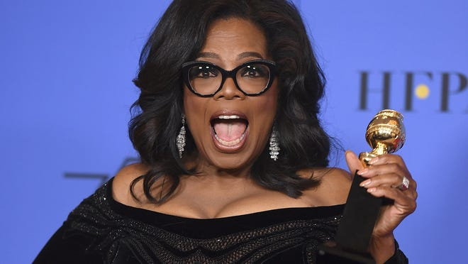 FILE - In this Sunday, Jan. 7, 2018 file photo, Oprah Winfrey poses in the press room with the Cecil B. DeMille Award at the 75th annual Golden Globe Awards in Beverly Hills, Calif. On Friday, Jan. 19, 2018, The Associated Press has found that stories circulating on the internet about Winfrey saying that old white people need to die are untrue. (Photo by Jordan Strauss/Invision/AP)