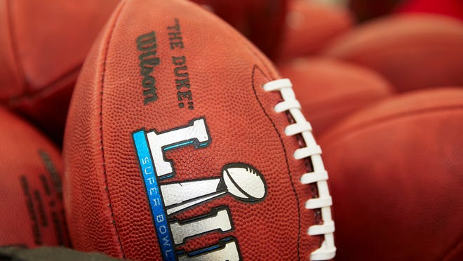 Official balls for the NFL Super Bowl LII football game are seen at the Wilson Sporting Goods Co. in Ada, Ohio, Monday, Jan. 22, 2018. The New England Patriots will play the Philadelphia Eagles in the Super Bowl on Feb. 4, in Minneapolis, MN. (AP Photo/Rick Osentoski)