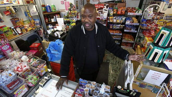 """In this Feb. 26, 2018 photo, Carl Lewis talks in his market in Rankin, Pa. About half of Lewis' customers pay with benefits from the federal Supplemental Nutrition Assistance Program, so the government's proposal to replace the debit card-type program with a pre-assembled box of shelf-stable goods delivered to recipients worries him and other grocery operators in poor areas. """"If half your business goes away, it's going to hurt,"""" Lewis said. (AP Photo/Gene J. Puskar)"""