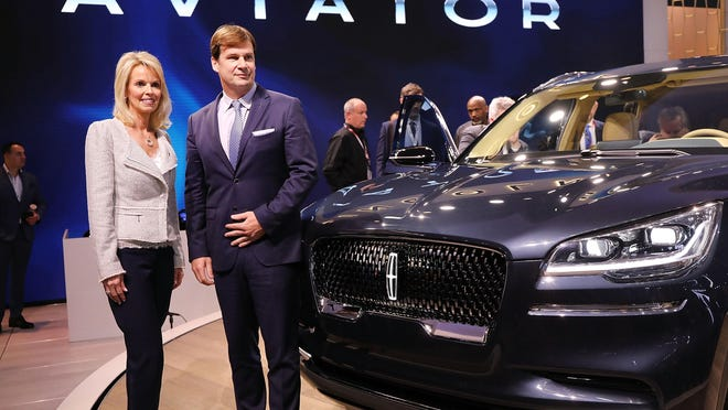 Lincoln Motor Company President Joy Falotico joins Ford Motor Company's Executive Vice President and president, Global Markets Jim Farley as the 2019 Lincoln Aviator SUV is unveiled at the New York International Auto Show at the Jacob K. Javits Convention Center on Wednesday in New York City.