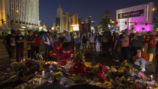 A crowd gathers Wednesday, Oct. 4, 2017 to pay tribute at a memorial for the victims of the mass shooting near the crime scene off Las Vegas Boulevard in Las Vegas, Nev. (Gina Ferazzi/Los Angeles Times/TNS)