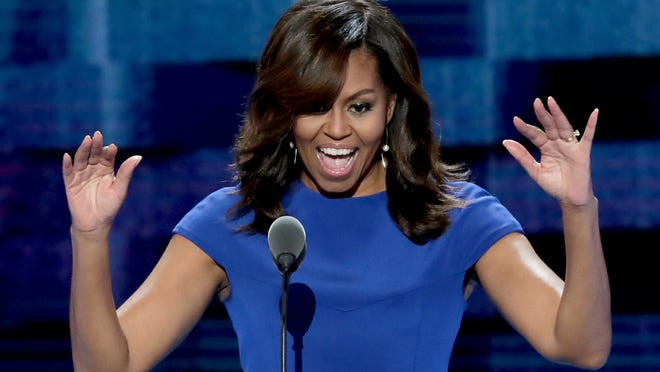 PHILADELPHIA, PA - JULY 25:  First lady Michelle Obama acknowledges the crowd before delivering remarks on the first day of the Democratic National Convention at the Wells Fargo Center, July 25, 2016 in Philadelphia, Pennsylvania. An estimated 50,000 people are expected in Philadelphia, including hundreds of protesters and members of the media. The four-day Democratic National Convention kicked off July 25.  (Photo by Alex Wong/Getty Images)