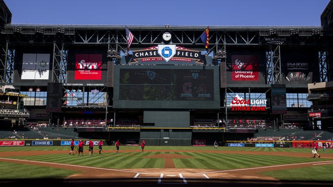 Field maintenance workers prepare the field before the Diamondbacks' last spring training game against the Indians on Tuesday, Mar. 27, 2018 at Chase Field in Phoenix. (Sean Logan/The Republic)