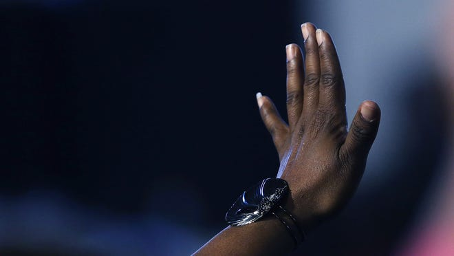 A woman raises her hand to ask a question to Democratic presidential candidate Hillary Clinton as she speaks to voters in South Carolina a day after her debate with rival candidate Bernie Sanders on February 12, 2016 in Denmark, South Carolina.  Clinton is counting on strong support from the African American community in South Carolina to give her a win over Sanders in the upcoming primary on February 27.  (Photo by Spencer Platt/Getty Images)