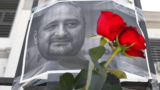 Flowers and a portrait of journalist Arkady Babchenko, who was reportedly killed in Kiev on May 29, 2018, by the Russian Embassy in Kiev. Babchenko said that his 'killing' was part of a special service operation during a briefing by Ukraine's Security Service (SBU) on May 30, 2018. (Pyotr Sivkov/Tass/Abaca Press/TNS)