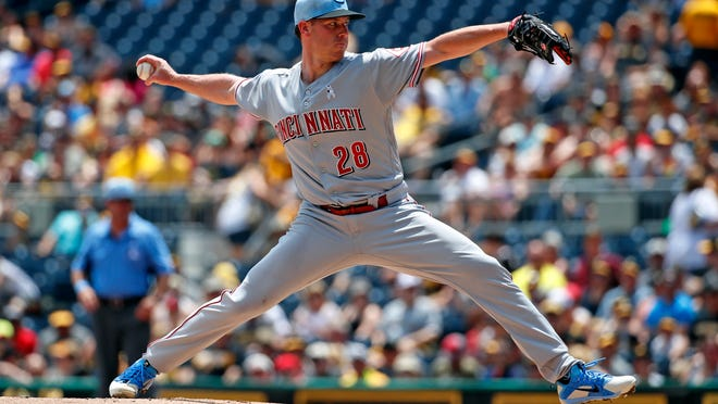Cincinnati Reds starting pitcher Anthony DeSclafani delivers in the first inning of a baseball game against the Pittsburgh Pirates in Pittsburgh, Sunday, June 17, 2018. (AP Photo/Gene J. Puskar)