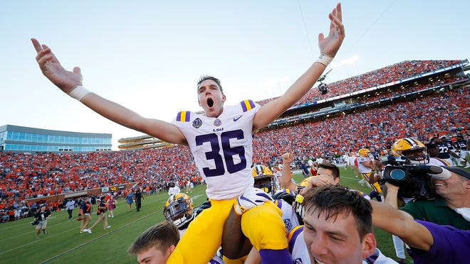 AUBURN, AL - SEPTEMBER 15:  Cole Tracy #36 of the LSU Tigers celebrates after kicking the game-winning field goal in their 22-21 win over the Auburn Tigers at Jordan-Hare Stadium on September 15, 2018 in Auburn, Alabama.  (Photo by Kevin C. Cox/Getty Images) ORG XMIT: 775198475 ORIG FILE ID: 1033931656