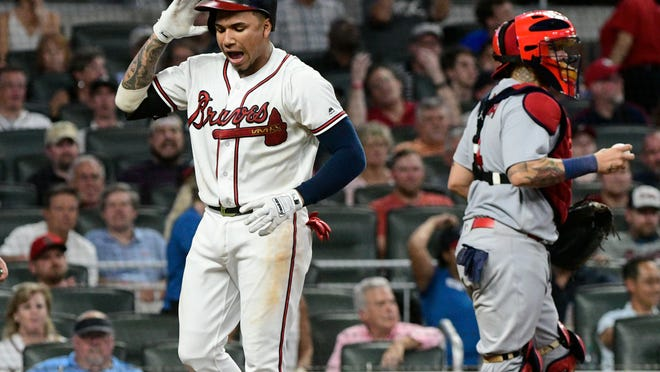 Atlanta Braves' Johan Camargo reacts after striking out to end the seventh inning of a baseball game against the St. Louis Cardinals, Monday, Sept. 17, 2018, in Atlanta. (AP Photo/John Amis)