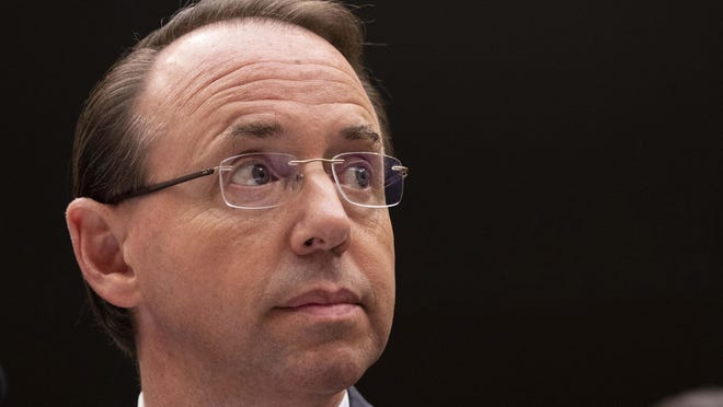 """United States Deputy Attorney General Rod Rosenstein listens during a United States House of Representatives Judiciary Committee hearing on Capitol Hill on June 28, 2018 in Washington, D.C. President Donald Trump says he would """"certainly prefer not"""" to fire Rosenstein and says he may delay a highly anticipated meeting with him."""