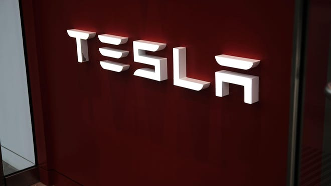 NEW YORK, NY - JUNE 06: A Tesla showroom stands in the Meatpacking district in Manhattan on June 6, 2018 in New York City. Tesla stock had its best day since November 2015 on Wednesday rising more than 9.5 percent after the company revealed it is nearing its Model 3 weekly production rate. Also, in a vote shareholders backed Elon Musk as chairman and CEO. (Photo by Spencer Platt/Getty Images)