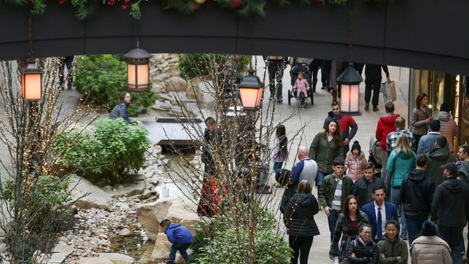 People do some last-minute Christmas shopping at City Creek Center in Salt Lake City on Saturday, Dec. 23, 2017.