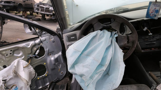 A deployed airbag is seen in a 2001 Honda Accord at a salvage yard on May 22, 2015 in Florida. More than three years after the government took over management of recalls involving dangerous Takata air bag inflators, one third of the recalled inflators still have not been replaced.